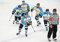 Mike Heffernan is surrounded by his team mates Travis Blinkhorn, Nick Pino, Andrew Gass and Grand Lundquist after scoring the first goal for the NH Fighting Spirit against the Cape Cod Islanders Friday evening at the Laconia Ice Arena.  (Karen Bobotas/for the Laconia Daily Sun)