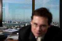 10 JAN 2005, BERLIN/GERMANY:<br /> Blich ueber Berlin, hinter Roger Koeppel, Chefredakteur der Tageszeitung Die Welt, waehrend einem Interview, in seinem Buero, Axel-Springer-Haus<br /> IMAGE: 20050110-02-064<br /> KEYWORDS: Roger Köppel
