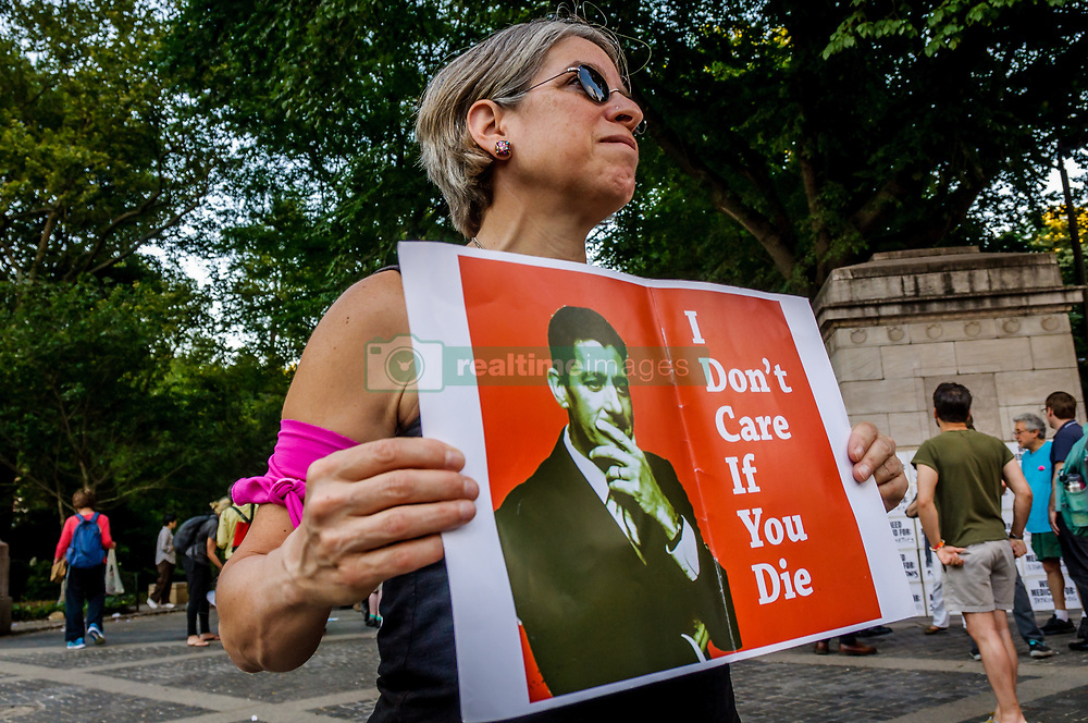 """June 21, 2017 - New York, United States - NYC healthcare and resistance activists and allies organized a round-the-clock and overnight protest in advance of Possible U.S. Senate """"TrumpCare"""" debate and vote next week. New Yorkers on Medicaid and ACA plans gathered share stories and bear witness to what's at stake during the 24-hour vigil to save our healthcare in front of the Globe Statue outside Trump International Hotel on Columbus Circle in Manhattan on June 21 at 5 p.m. through June 22 at 5 p.m. (Credit Image: © Erik Mcgregor/Pacific Press via ZUMA Wire)"""