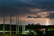 Lightning streaks across the sky behind power lines in the Town of Wallkill, N.Y., during a thunderstorm  on May 15, 2020.