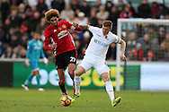 Marouane Fellaini of Manchester Utd  challenges Alfie Mawson of Swansea city. Premier league match, Swansea city v Manchester Utd at the Liberty Stadium in Swansea, South Wales on Sunday 6th November 2016.<br /> pic by  Andrew Orchard, Andrew Orchard sports photography.
