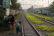 Children playing on the railway lines on 9th June 2018 in Jakarta, Java, Indonesia.