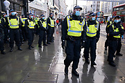 Heavy police presence dealing with anti-vaxxer protesters who had fragmented across the West End as the Prime Minister announces a new tighter fourth tier of local coronavirus restrictions for London and the South East, and that the planned Christmas relaxation of the rules was to be scrapped on 19th December 2020 in London, United Kingdom. Vaccine hesitancy, also known as anti-vaccination or anti-vax, is a reluctance or refusal to be vaccinated or to have ones children vaccinated against contagious diseases despite the availability of vaccination services.