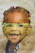 May 23, 2007,  Moldy photograph of a child found in a home  destroyed by Hurricane Katrina in New Orleans.