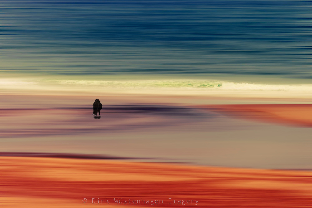 Silhouette of a couple on a beach - abstracted photograph
