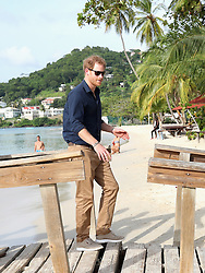 Prince Harry visits Grand Anse Beach in Grenada during the second leg of his Caribbean tour.