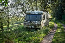 Abandoned touring caravan on a farm track, Boundary, Staffordshire, England, UK.<br /> Photo: © Ed Maynard<br /> 07976 239803<br /> www.edmaynard.com