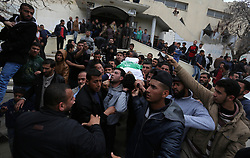 March 24, 2019 - Beit Hanoun, Gaza Strip, Palestinian Territory - Mourners carry the body of Palestinian Habib Al Masry, 24, who was shot dead by Israeli forces during clashes with Israeli troops in tents protest where Palestinians demand the right to return to their homeland at the Israel-Gaza border, during his funeral, in Beit Hanoun in the northern Gaza Strip, on March 24, 2019  (Credit Image: © Ashraf Amra/APA Images via ZUMA Wire)