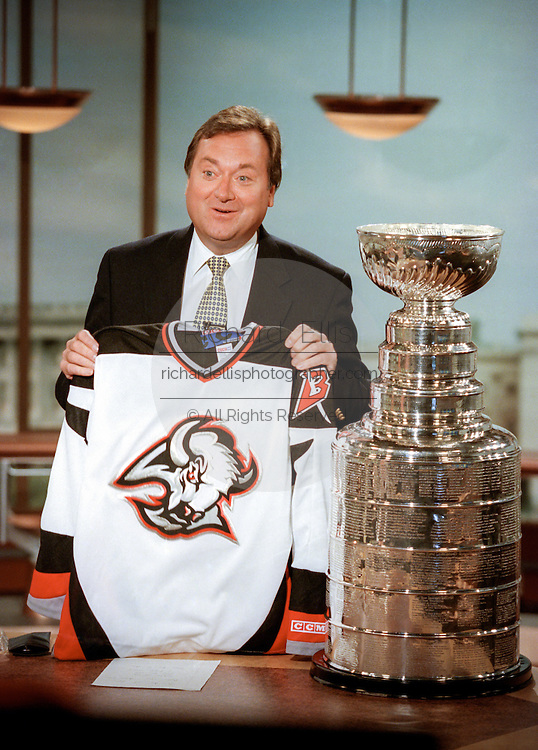 Tim Russert, host of NBC's Meet the Press holds a Buffalo Sabers jersey as he stands with the Stanley Cup June 6, 1999 in Washington, DC. Russert, originally from Buffalo showed his support for his home team who will play in the upcoming Stanley Cup finals against Dallas.