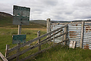 Rusted corrugated iron in abandoned livestock farm pens in Glen Bauchor, Newtonmore, Scotland.