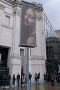 Arts and culture lovers queue outside the National Gallery beneath a banner for the current art exihibition of Italian Baroque artist, Artemisia Gentileschi, on 24th May 2021, in London, England.