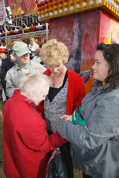 Day Service staff with group of people with learning disabilities at Goose Fair, Nottingham
