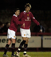 Photo: Jed Wee.<br /> Manchester United Reserves v Bolton Wanderers Reserves.<br /> 15/12/2005.<br /> <br /> Manchester United's Ole Gunnar Solskjaer (L) celebrates their first goal with Gerard Pique.