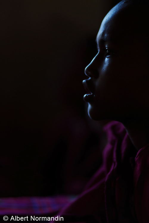 Young Monk listens carefully in class in dramatic light, Zwé Taw Monastery and Education School