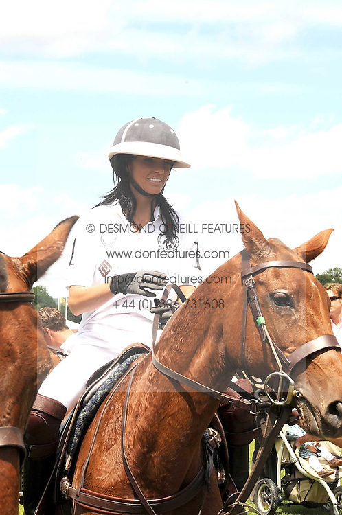 KATIE PRICE - model Jordan at a Pro-Celebrity Polo match in aid of the Mark Davies Injured Riders Fund Charity Day held at Cowdray Park, West Sussex on 22nd June 2008.<br /><br />NON EXCLUSIVE - WORLD RIGHTS