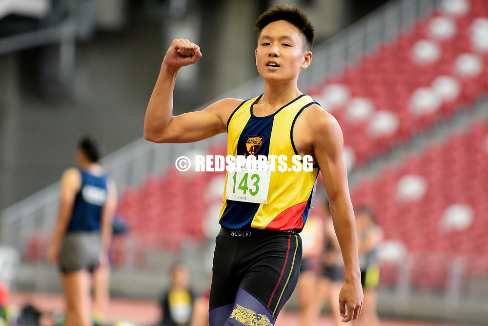 Mark Lee (#143) of Anglo-Chinese School (Independent) celebrates after winning the C Division boys' 100m final with a timing of 11.59s. (Photo © Eileen Chew/Red Sports)