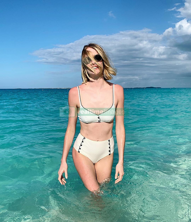 """Lindsay Ellingson releases a photo on Instagram with the following caption: """"Here for the week! \u2600\ufe0f\u26f1\u2728"""". Photo Credit: Instagram *** No USA Distribution *** For Editorial Use Only *** Not to be Published in Books or Photo Books ***  Please note: Fees charged by the agency are for the agency's services only, and do not, nor are they intended to, convey to the user any ownership of Copyright or License in the material. The agency does not claim any ownership including but not limited to Copyright or License in the attached material. By publishing this material you expressly agree to indemnify and to hold the agency and its directors, shareholders and employees harmless from any loss, claims, damages, demands, expenses (including legal fees), or any causes of action or allegation against the agency arising out of or connected in any way with publication of the material."""