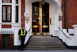 © Licensed to London News Pictures. 20/06/2012. LONDON, UK. A policeman stands at the entrance to the Ecuadorian Embassy in London where Wikileaks founder Julian Assange is staying whilst seeking asylum. Assange, who has fought extradition to Sweden over alleged sex crimes, may be arrested if he is not granted asylum due to breaching the terms of his bail agreement. Photo credit: Matt Cetti-Roberts/LNP