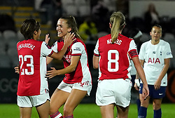 Arsenal's Mana Iwabuchi (left) celebrates scoring their side's first goal of the game with team-mates during the Vitality Women's FA Cup quarter final match at Borehamwood, London. Picture date: Wednesday September 29, 2021.