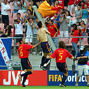 Spain's Fernando Morientes throw his shirt towards the crowd in celebration of scoring Spain's first goal