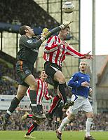 Photo: Aidan Ellis.<br /> Everton v Sunderland. The Barclays Premiership. 01/04/2006.<br /> everton keeper Richard Wright just gets to the ball before Sunderland's Chris Brown
