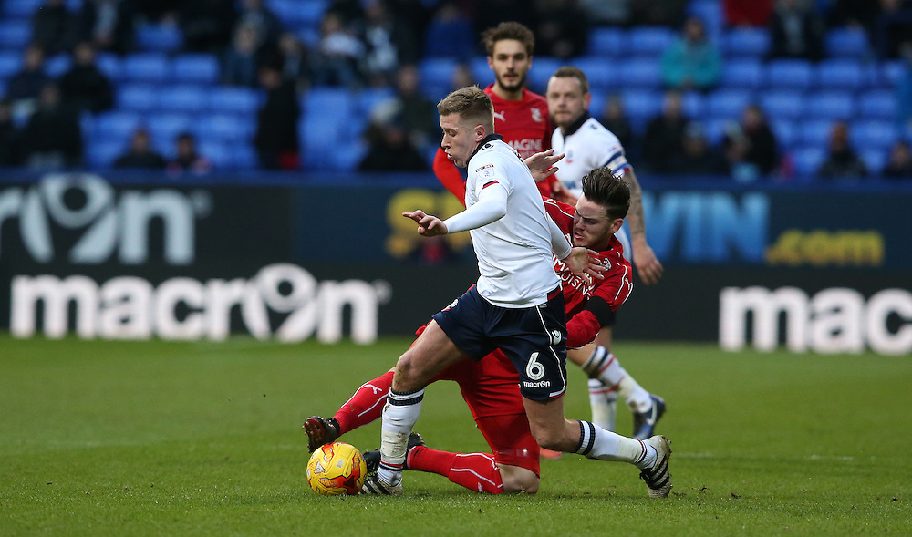Bolton Wanderers' Josh Vela is tackled by Swindon Town's Ben Gladwin<br /> <br /> Photographer Stephen White/CameraSport<br /> <br /> The EFL Sky Bet League One - Bolton Wanderers v Swindon Town - Saturday 14th January 2017 - Macron Stadium - Bolton<br /> <br /> World Copyright © 2017 CameraSport. All rights reserved. 43 Linden Ave. Countesthorpe. Leicester. England. LE8 5PG - Tel: +44 (0) 116 277 4147 - admin@camerasport.com - www.camerasport.com