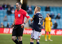 Football - 2018 / 2019 Emirates FA Cup - Sixth Round, Quarter Final : Millwall vs. Brighton<br /> <br /> Shane Ferguson (Millwall FC) reacts after realising his error as Referee Christopher Kavanagh places the red card back into his pocket at The Den.<br /> <br /> COLORSPORT/DANIEL BEARHAM