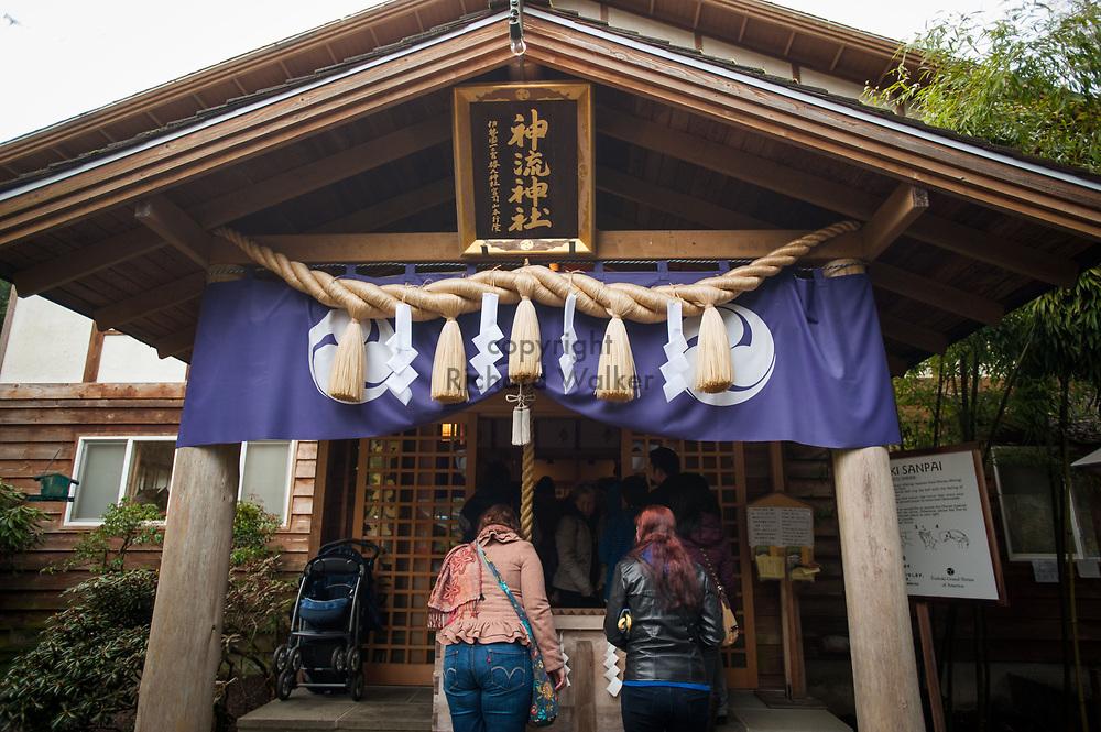 2014 January 01 - People pray at Tsubaki Grand Shrine, Granite Falls, WA. New Years Hatsumode. By Richard Walker