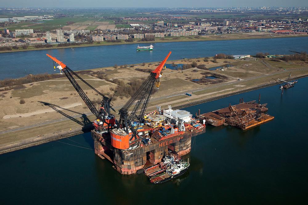 Nederland, Zuid-Holland, Rotterdam, 20-03-2009; Hermod, kraanschip van Heerema Marine Contractors (HMC) in het Calandkanaal. Het werkschip is een zgn. half-afzinkbaar schip waardoor het schip ook onder extreme weersomstandigheden operationeel kan zijn. Het schip heeft een helikopterdek (heliplat) en is voorzien van twee kranen voor gebruik bij constructiewerkzaamheden in de offshore.In de achtergrond maassluis en de kassen van het Westland..Hermod, semi submersible crane vessel (SSCV) of Heerema Group. The ship has two cranes for offshore construction and a helicopter deck (or heli pad).Swart collectie, luchtfoto (toeslag); Swart Collection, aerial photo (additional fee required).foto Siebe Swart / photo Siebe Swart