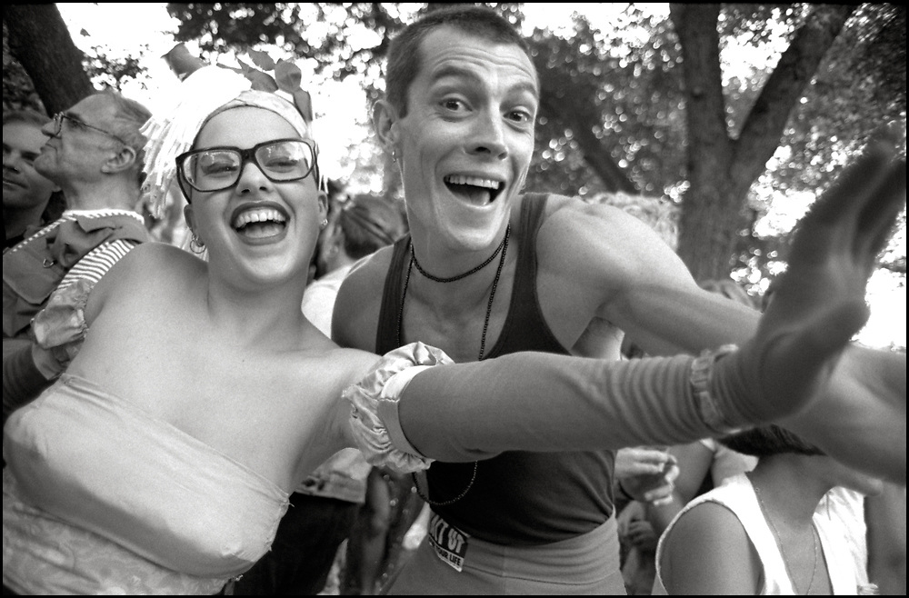 Garance Franke-Ruta, Larry Kramer, Phil Zwickler and others at Wigstock, an annual outdoor drag festival that began in the 1980s in Tompkins Square Park in the East Village of New York City that took place on Labor Day in 1989.