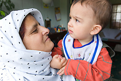 Grandmother comforting her baby grandson,