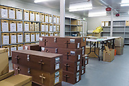 At CMP's lab in the Cypriot buffer zone, excavated human remains are stored alongside coffins for future burials.