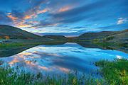Clouds at sunset reflected in wetland <br /> Saskatchewan Landing Provincial Park<br /> Saskatchewan<br /> Canada