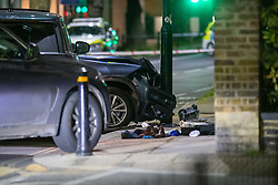 **Incident reported to be connected with the death of Multi-millionaire hotelier Sir Richard Sutton in Dorset**<br /> © Licensed to London News Pictures. 08/04/2021. London, UK. A vehicle that has crashed into a pole and items of clothing on Chiswick High Road following a incident in which a vehicle was stopped at approximately 22:30hrs on Wednesday 07/04/2021 when police approached the vehicle, officers discovered the lone male occupant had sustained a number of serious self-inflicted injuries. First aid was commenced immediately and the London Ambulance Service were called. The male has been taken to a west London hospital. Photo credit: Peter Manning/LNP