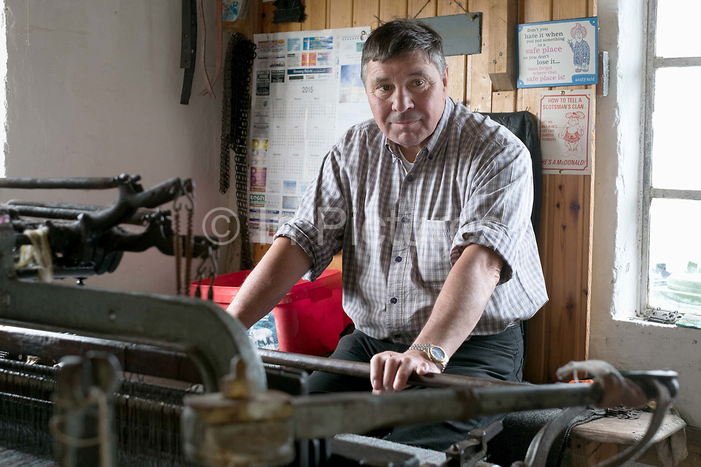 Donald MacDonald, Harris Tweed weaver, Shawbost, Isle of Lewis, Outer Hebrides, Scotland on 19 July 2018. Harris Tweed must be made from pure virgin wool which has been dyed and spun on the islands and handwoven at the home of the weaver in the Outer Hebrides of Scotland.