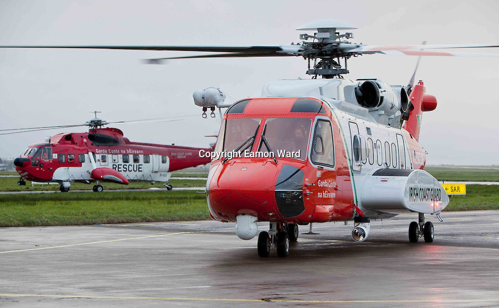 The new Coast Guard Sikorsky S-92 helicopter which arrived at Shannon airport today with the older S-61 Coast Guard helicopter in the background. Photograph by Eamon Ward (Pat Flynn has sent story)