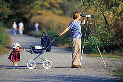 Woman Bird Watching With Baby