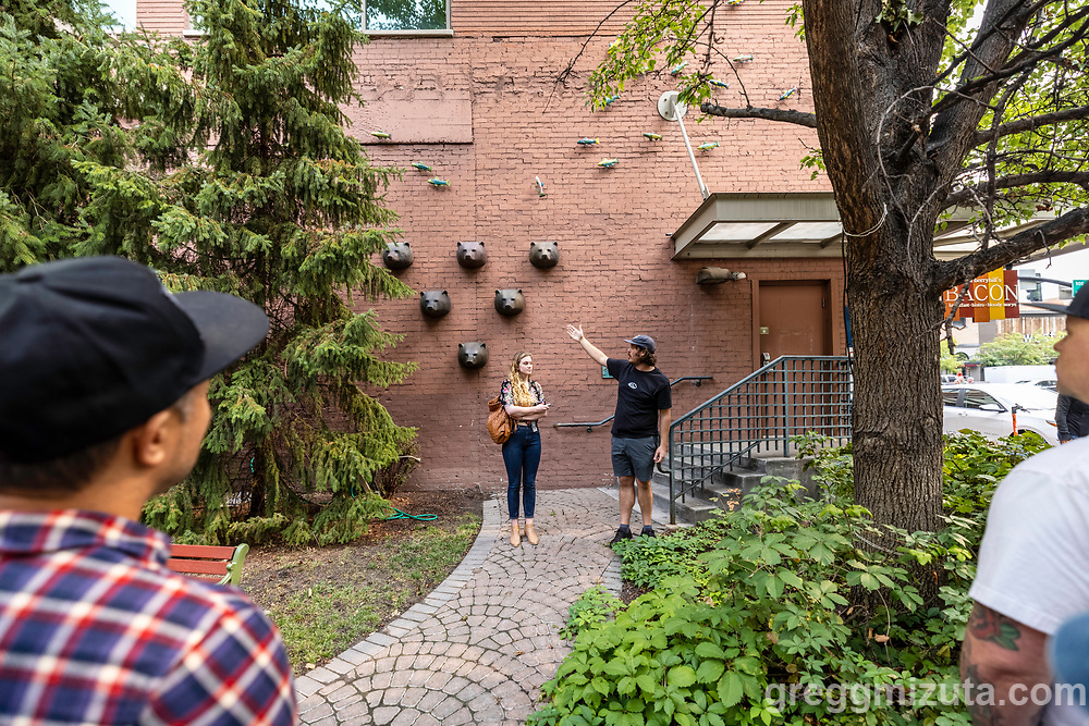 Karl LeClair and Catina Crum. Boise City's Public Art Program Manager Karl LeClair leads a walking tour to explore the City of Boise's public art collection on August 21, 2021. The tour began and ended on the Capitol Blvd. plaza at City Hall (150 N. Capitol Blvd.).<br /> <br /> Spring Run, 1994, Marilyn Lysohir, Plaza 121, 121 9th St. Six cast-metal bear heads and forty-six ceramic fish enliven the wall of a downtown pocket park.