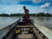 21 NOVEMBER 2017 - WAKEMA, AYEYARWADY REGION, MYANMAR:  A boatman on a branch of Irawaddy River in Wakema.   PHOTO BY JACK KURTZ