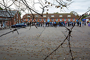 Refugees inside the barracks came out into the yard to enjoy the locals 'Welcome To Folkestone' event from local residents and community groups including Kent Refugee Action Network and Samphire came together outside Napier Barracks to show the people staying there that they are welcome to the town on the 17th of October 2020 in Folkestone, United Kingdom. In September 2020 Napier Barracks a former military camp was transformed into an assessment and dispersal facility for 400 asylum seekers by the Home Office. (photo by Andrew Aitchison / In Pictures via Getty Images)