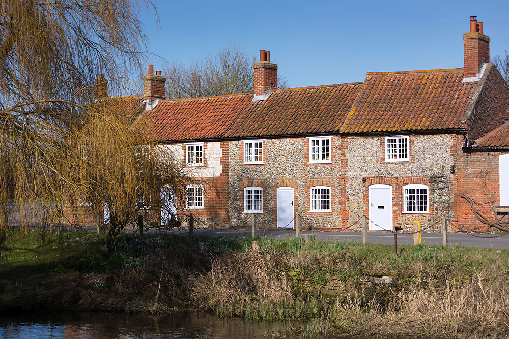Traditional brick and flint cottages typical in North Norfolk near Burnham Ovary Staithe, UK