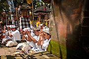 "Apr. 22 - UBUD, BALI, INDONESIA: Hindus in Bali pray during an Odalan ceremony in a family temple in Ubud, Bali, Indonesia. The Odalan ceremony is the ""birthday"" ceremony for Hindu temples in Bali and are held every 210 days. They are common in Bali.   Photo by Jack Kurtz/ZUMA Press."