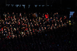 Fans shield their eyes in the sunshine