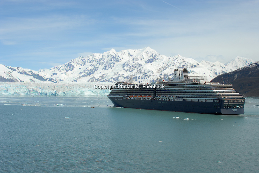 Passengers stand on the top level of the Holland America cruise ship ms Westerdam as it approaches the Hubbard Glacier between the Russell Fiord and Disenchantment Bay in Alaska. (Photo by Phelan M. Ebenhack)