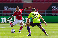 Bristol City's Jack Hunt (2) is watched by Exeter City's Lewis Page (20) during the EFL Cup match between Bristol City and Exeter City at Ashton Gate, Bristol, England on 5 September 2020.