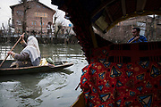 Both male and female are here efficient in rowing boats as this is the only mode of transport.Srinagar, © Sandipa Malakar.