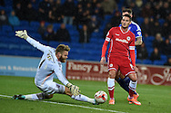 Cardiff city's Federico Macheda (14 ) is denied by  Ipswich keeper Dean Gerken. Skybet football league championship match, Cardiff city v Ipswich Town at the Cardiff city stadium in Cardiff, South Wales on Tuesday 21st October 2014<br /> pic by Andrew Orchard, Andrew Orchard sports photography.