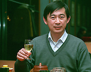 Li Demei, Vice-General Manager, Responsible for Techniques at the Sino-French Demonstration Vineyard, giving a toast in a glass of white Chinese wine Beijing, China, Asia