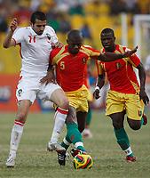 Photo: Steve Bond/Richard Lane Photography.<br />Guinea v Morocco. Africa Cup of Nations. 24/01/2008. Monsef Zerka (L) tries to get in front of Bobo Balde (C)