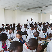 INDIVIDUAL(S) PHOTOGRAPHED: . LOCATION: University of the Artistide Foundation (UNIFA), Tabarre Commune, Port-au-Prince, Haïti. CAPTION: Medical students from the University of the Artistide Foundation (UNIFA) work to complete a training questionnaire.